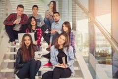 Happy teen girls and boys on the stairs school or college. Royalty Free Stock Photo