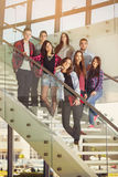 Happy teen girls and boys on the stairs school or college. Selective focus Royalty Free Stock Image