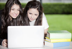 Happy teen girls with computer Royalty Free Stock Images