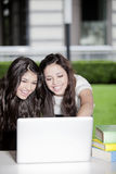 Happy teen girls with computer Royalty Free Stock Photo