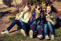 Happy teen girls eating an ice cream outdoor Royalty Free Stock Images