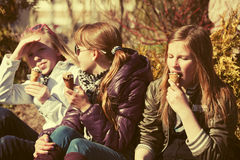 Happy teen girls eating an ice cream outdoor Royalty Free Stock Image