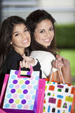 Happy teen girls with shopping bags Stock Images