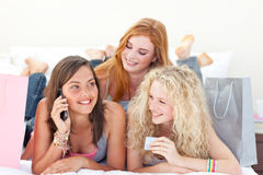 Happy teen girls after shopping clothes Stock Photos