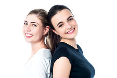 Happy teen girls standing back to back Royalty Free Stock Photo