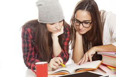 Happy teen girls studying Royalty Free Stock Photography