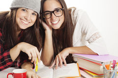 Happy teen girls studying Royalty Free Stock Photos