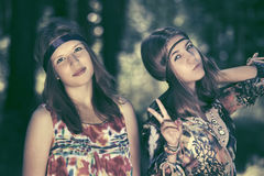 Happy teen girls walking in summer forest Royalty Free Stock Image