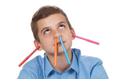 Happy teen. Pencils mess at home. Funny way to have fun. Royalty Free Stock Images