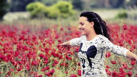 Happy teen in poppies field Stock Photo