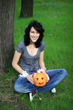 Happy teen with pumpkin Stock Photos