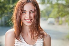 Happy teen redhead women smiling outdoors closeup image Royalty Free Stock Images