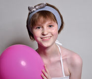 A happy teen with a rosy balloon Stock Photo