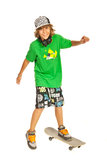 Happy teen on skateboard in action Royalty Free Stock Photos
