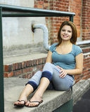 Happy Teen on the Stoop Royalty Free Stock Photography
