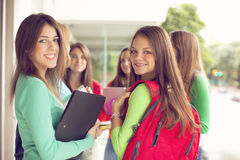Happy teen students smiling Royalty Free Stock Image