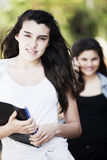 Happy teen students. Smiling outdoors with books Stock Images