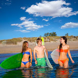 Happy teen surfers talking on beach shore Royalty Free Stock Photo