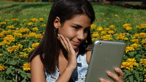 Happy Teen With Tablet. Stock photo of a teen girl Stock Photos