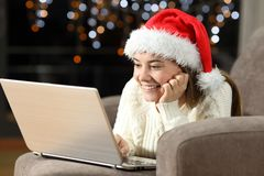 Happy teen watching on line content in christmas royalty free stock image