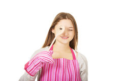 Happy teen woman wearing kitchen apron. Stock Photo