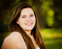 Happy teenage or adolescent girl outdoors Royalty Free Stock Photography