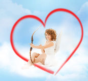 Happy teenage angel girl with bow and arrow Royalty Free Stock Image