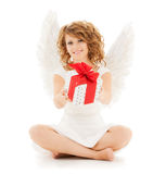 Happy teenage angel girl with christmas gift. Holidays, xmas and costumes concept - happy teenage angel girl with christmas gift Royalty Free Stock Photo