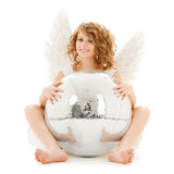 Happy teenage angel girl with disco ball Stock Photos