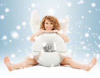 Happy teenage angel girl with disco ball Royalty Free Stock Photos