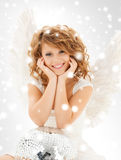 Happy teenage angel girl with disco ball Stock Image
