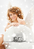 Happy teenage angel girl with disco ball Stock Photography