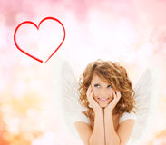 Happy teenage angel girl Stock Photo