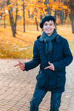 Happy teenage boy in the autumn sunny park Royalty Free Stock Photo