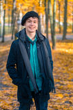 Happy teenage boy in the autumn sunny park Stock Photography
