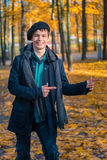 Happy teenage boy in the autumn sunny park Royalty Free Stock Images