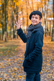 Happy teenage boy in the autumn sunny park Stock Photo