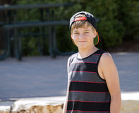 A Happy Teenage Boy in a Cap Smiles for a Portrait Royalty Free Stock Images