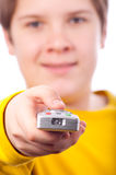 Happy teenage boy changing channels on television Royalty Free Stock Image