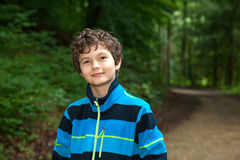 Happy teenage boy. A teenage boy in a forest is very happy, smiling very friendly Royalty Free Stock Image