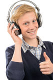 Happy teenage boy with headphones thumb-up Royalty Free Stock Images