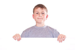 Happy teenage boy holding a blank form Royalty Free Stock Photography