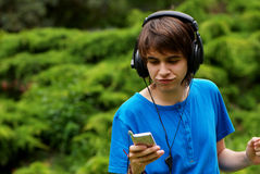 Happy Teenage Boy In Headphones Stock Image