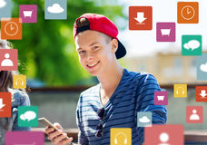 Happy teenage boy with smartphone outdoors Royalty Free Stock Photos