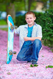Happy teenage boy in spring park Royalty Free Stock Images