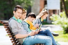 Happy teenage boy with tablet pc and headphones Stock Images