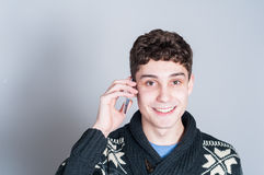Happy teenage boy talking on his cell phone. Teenage boy with a big smile talking on his cell phone Stock Photo