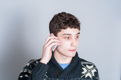 Happy teenage boy talking on his cell phone Stock Photo