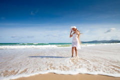 Happy teenage child in white dress on beach Royalty Free Stock Images
