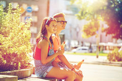 Happy teenage couple eating hot dogs in city Stock Photo